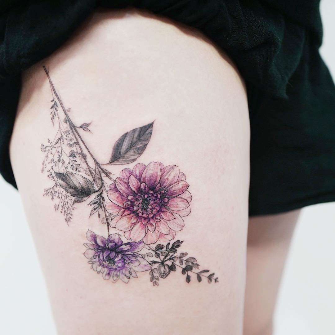 The thigh is an ideal place for applying tattoo images, which if desired can be easily hidden