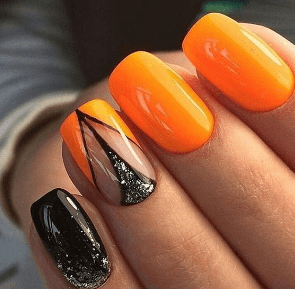 Оранжевый маникюр с черным дизайном геометрия