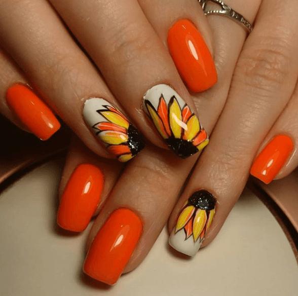 Оранжевый маникюр с дизайном подсолнух