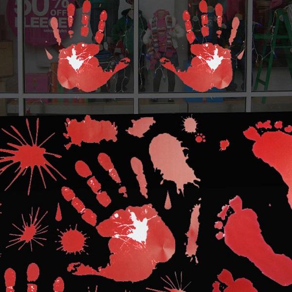 Красные отпечатки рук и ног