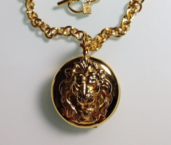 Медальон лев