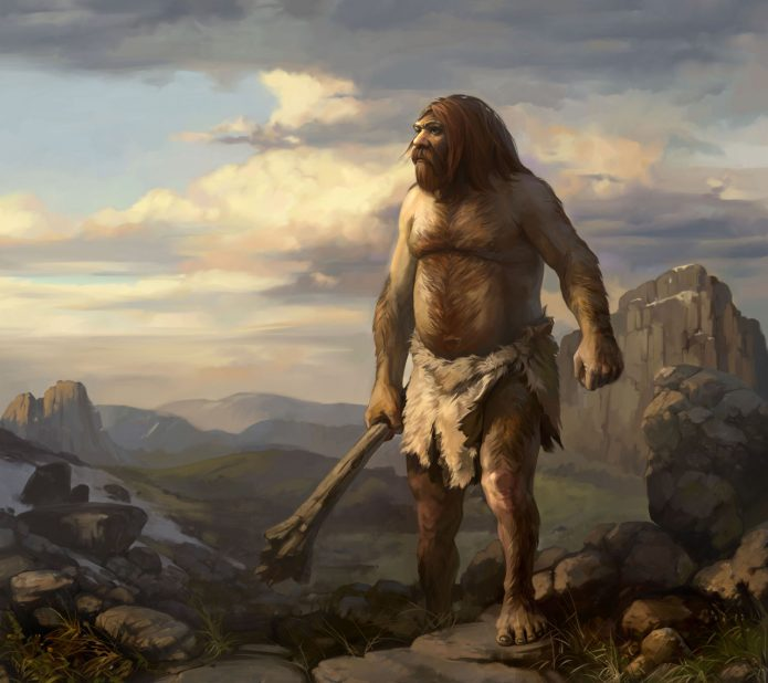волосатый пещерный человек с дубинкой на скале