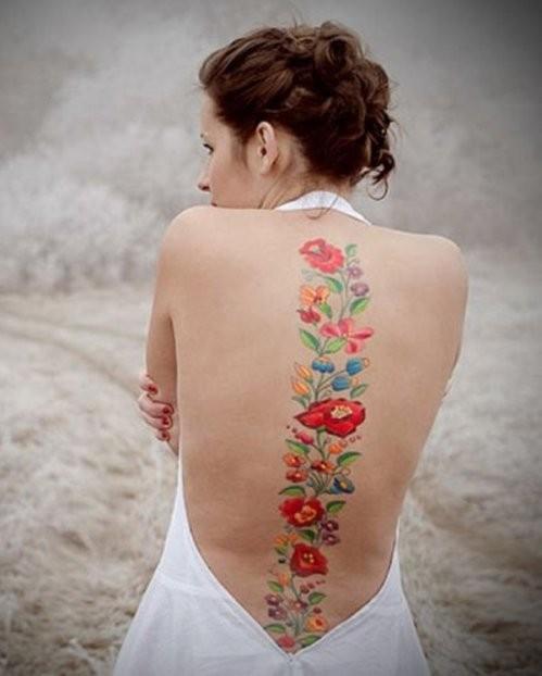 тату для девушек цветы вдоль позвоночника