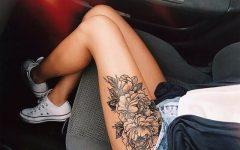 Татуировка на бедре девушки