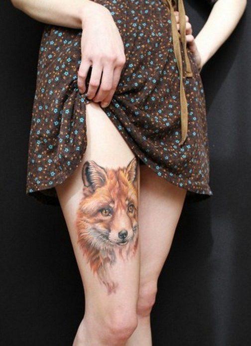 татуировка на женском бедре лиса