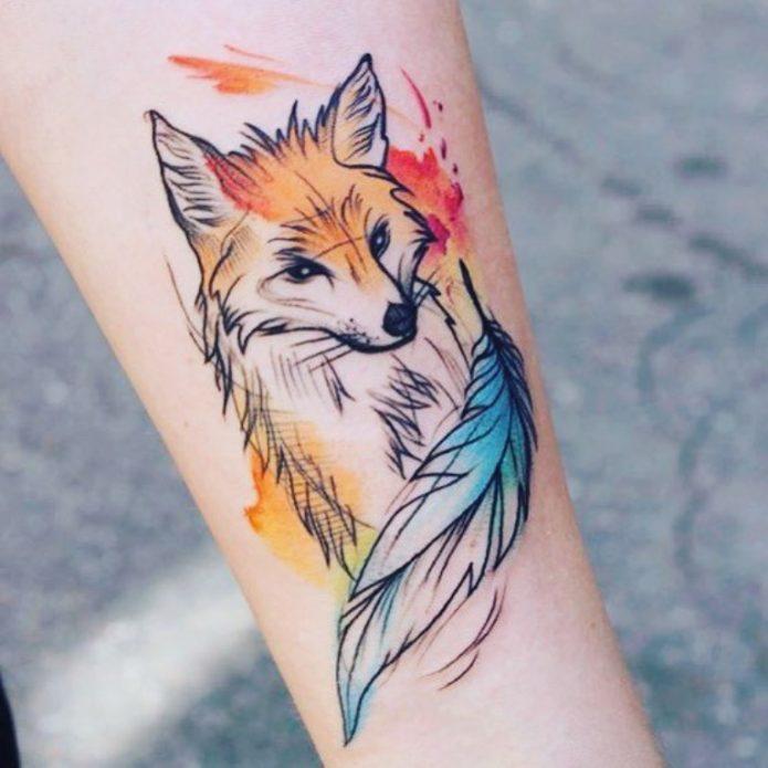 акварельная лиса татуировка на руке