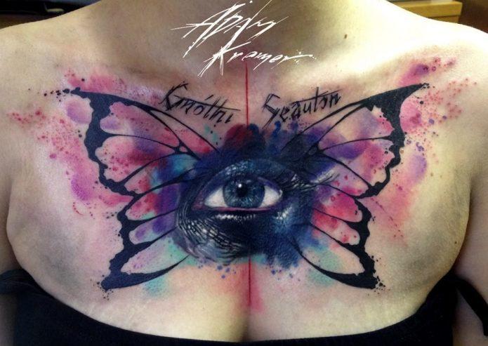 тату акварелью бабочка и глаз, женские тату на грудь