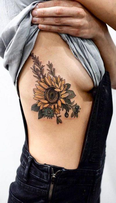 татуировка на рёбрах подсолнух