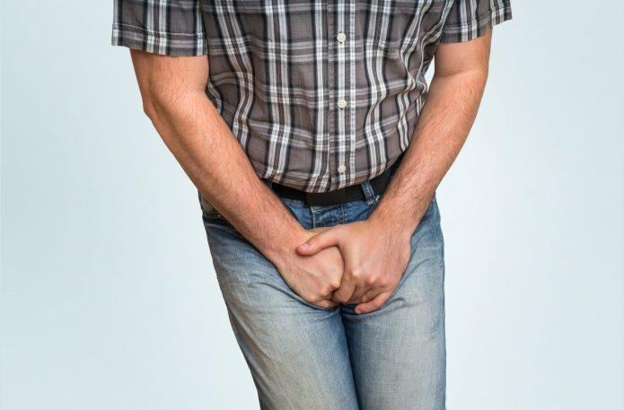 Боль в мошонке у мужчины